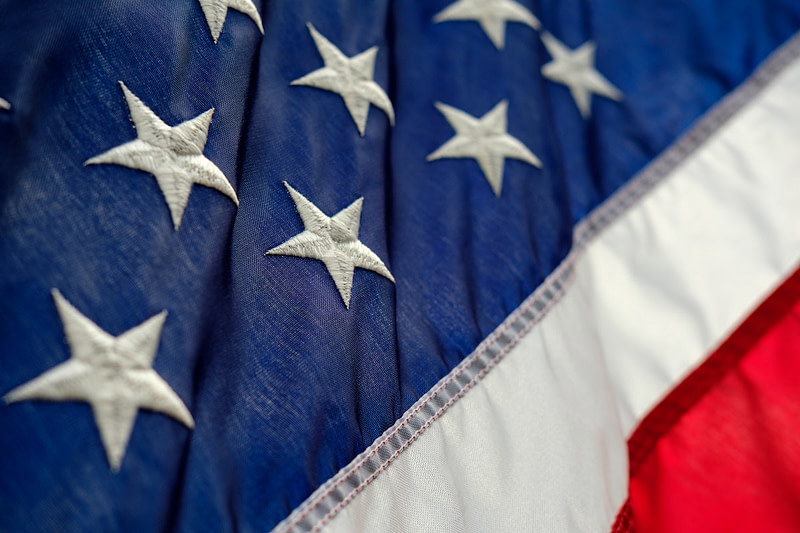 An image of the US flag in an article explaining how to get a work visa on the resume page of gugulet.hu