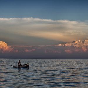 A fisherman starting his night shift on Lake Malawi