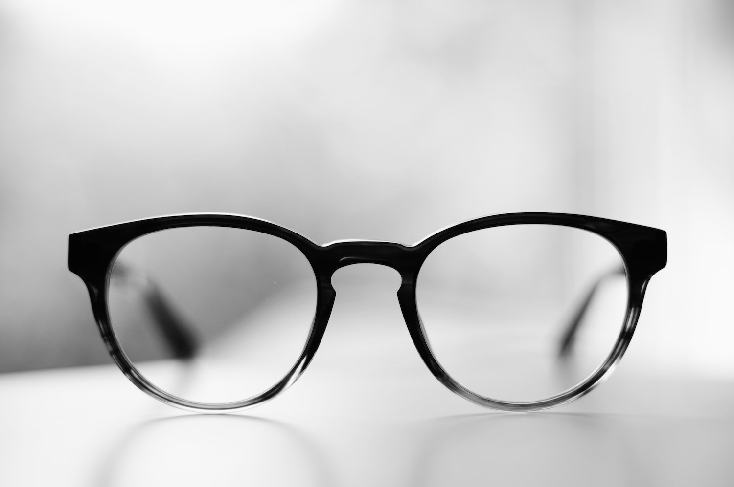 A pair of glasses in an article about how to read fund factsheets.