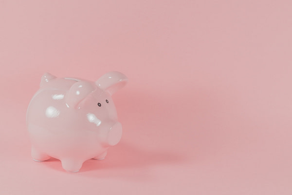 An image of a piggy bank in an article about Open Banking in the UK.